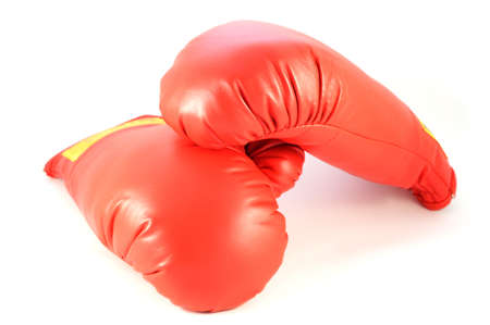An isolated shot of a pair of red boxing training gloves. Stockfoto