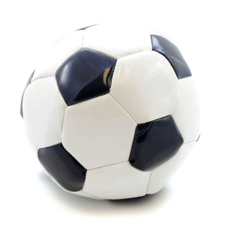 A closeup view of an isolated soccer ball for playing the team sport on a field.