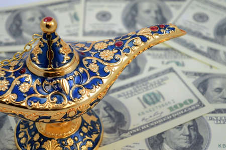A magic genie lamp overtop of an abundance of American money for the wishful thinking to accumulate riches.