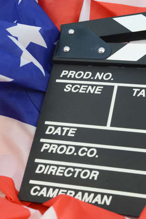 A movie clapboard and American flag for representing the American made film industry.