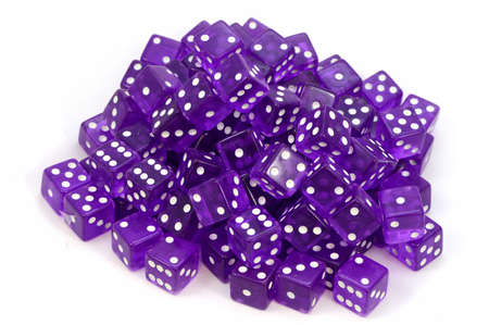 An isolated mound of 100 purple gaming dice for playing at the casino.