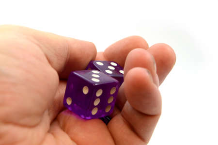 A player is ready to toss the pair of dice during game time.