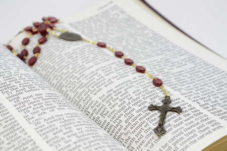 An open bible and rosary for the faithful believer.