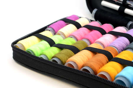 A closeup of colorful sewing threads found in a kit for repairs. Stock Photo