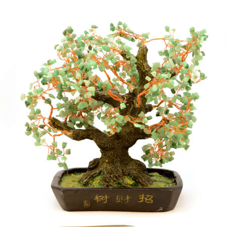An isolated shot of a money tree created from green jade stones and copper wire to attract wealth into ones life.