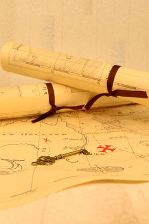 An old fashioned map and key outlining a path to reveal buried treasure at the x marking the spot. Reklamní fotografie