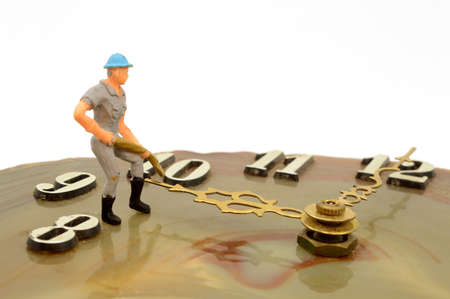 A scale model man pushes time forward.