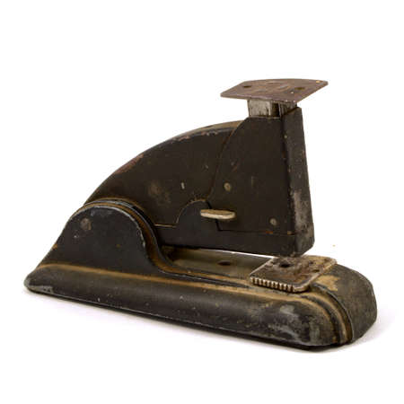 An isolated over white image of an antique stapler.
