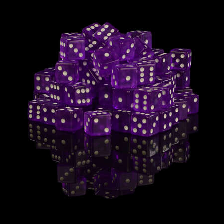 A heaping pile of new unused casino grade dice with a black reflective surface background.