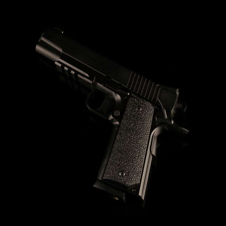A model 1911 replica hand gun used for combat and law enforcement. Фото со стока