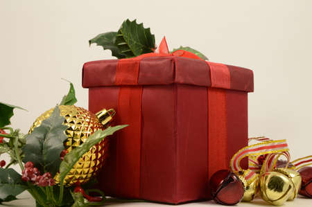 A red gift box to be given during the holiday season festivities.