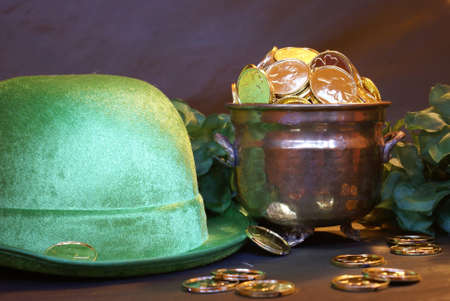 A closeup scene of a Leprechauns pot of gold and his hat.