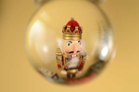 A festive nutcracker is viewed inside a crystal ball during the Christmas holidays. Stock Photo