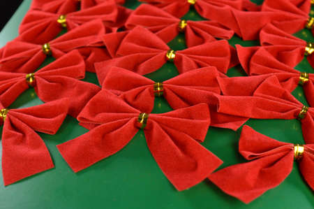 A full set of packaged decorative red bows used during the Christmas holiday season for dressing up the tree or gifts. Stockfoto