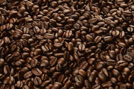 A closeup macro shot of freshly roasted coffee beans to create a full frame background.