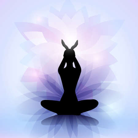 wellbeing: Female yoga silhouette with the lotus flower