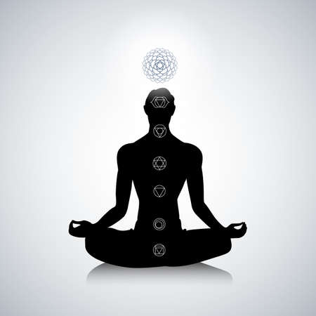 chakra energy: Male silhouette in yoga pose with abstract chakra symbols