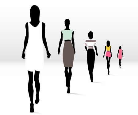 滑走路の上を歩くファッションの女性のグループ