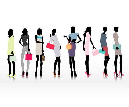 Grupo de los vestidos femeninos modelos en ropa de la manera con los bolsos, la compra