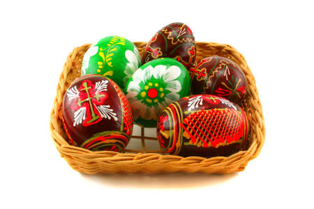 eastertide: Six Easter eggs in a basket on a white background Stock Photo