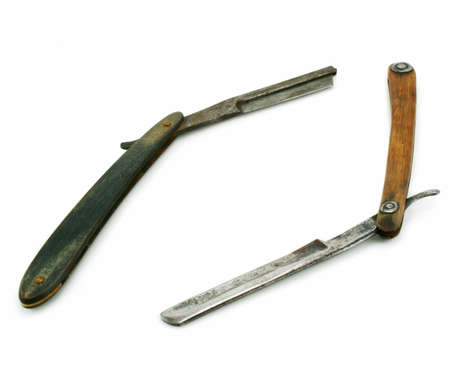 Two wooden cutthroat razors isolated on a white background photo