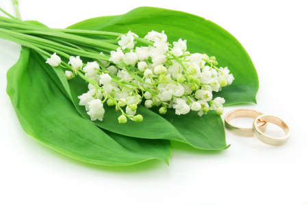 Lily of the Valley and Golden Rings Isolated on White Background photo