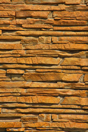 old building facade: A Stacked Stone Wall Texture Background Stock Photo