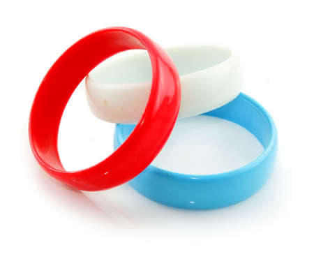rubber ring: Three colored plastic bracelets isolated on a white background Stock Photo