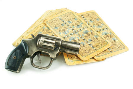 Gun and pack of cards isolated on a white background