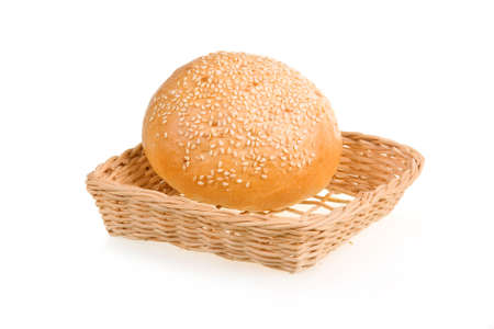 Baked Bun with Sesame in Basket Isolated on White Background photo