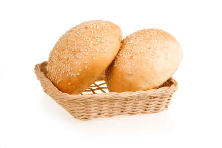 Two Baked Buns with Sesame in Basket Isolated on White Background photo