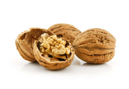 Close-up of a Walnut Fruits Isolated on White Background photo