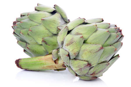 Ripe green artichoke vegetables isolated on white background