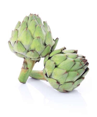 Ripe green artichoke vegetables isolated on white background