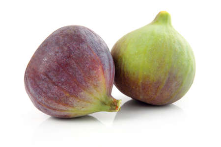 purple fig: Ripe purple and green fig fruit isolated on white background