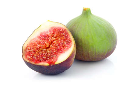 Ripe sliced purple and green fig fruit isolated on white background Stock Photo