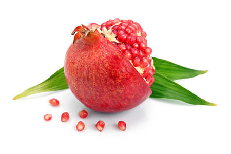 Pomegranate fruit with green leaf and cuts isolated on white background  Stock Photo