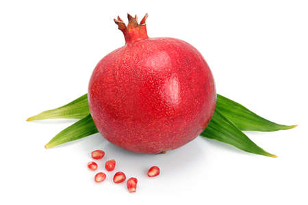 Pomegranate fruit with green leaf and seeds isolated on white background  Stock Photo