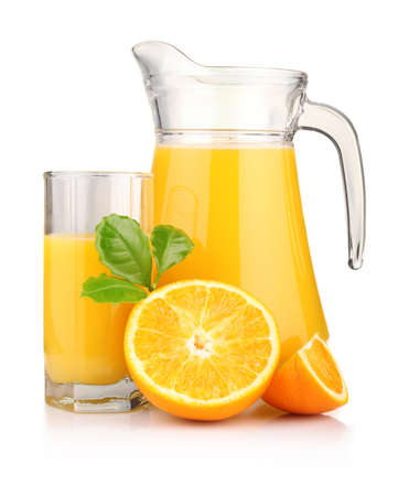 Jug, glass of orange juice and orange fruits with green leaves isolated on white