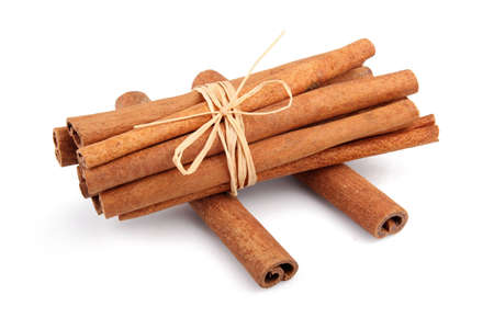 Bunch of cinnamon sticks isolated on white background Stock Photo - 9621781