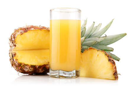 Glass of pineapple juice with fruit and slices isolated on white Stock Photo