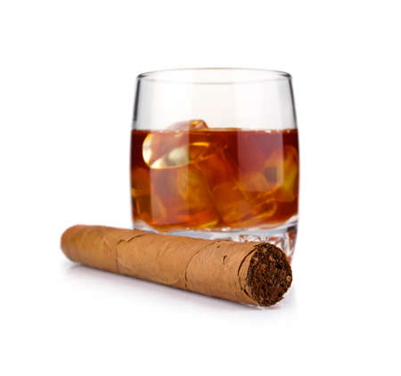brandy: Glass of whiskey with ice cubes and havana cigar isolated on white background Stock Photo