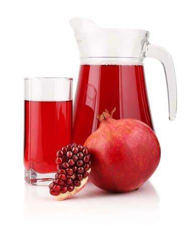 Jug and glass of  pomegranate juice with fruits isolated on white background Stock Photo