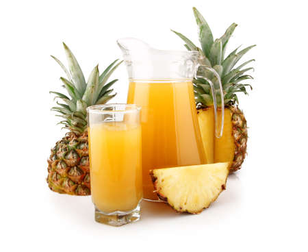 Jug and glass of pineapple juice with fruits isolated on white background Stock Photo