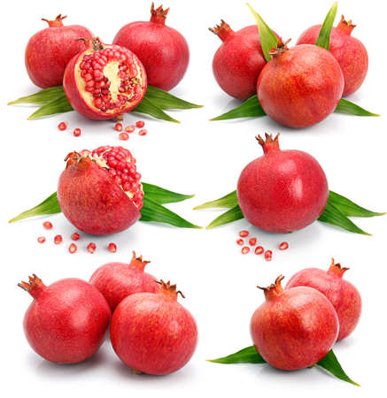 Set os pomegranate fruits with green leaf and cuts isolated on white background