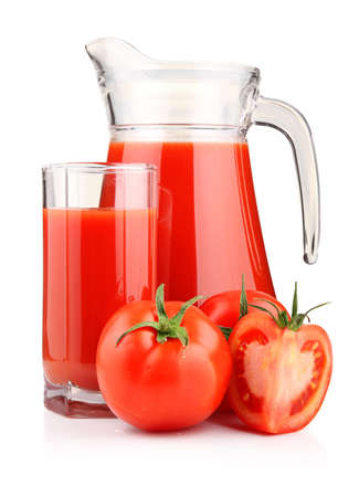 Jug, glass of tomato juice and fruits with green leaves isolated on white Stock Photo