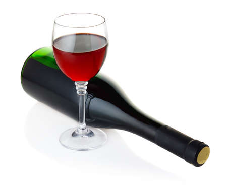 Bottle and goblet of red wine isolated on white background photo