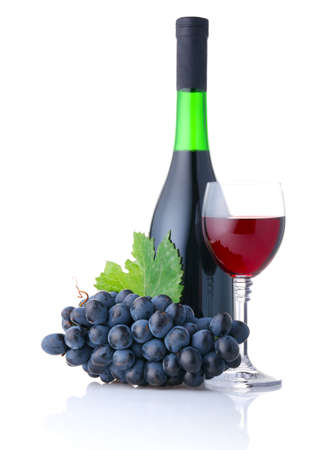 Bottle and goblet of red wine with branch of grapes isolated on white background Stock Photo