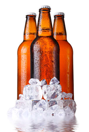 single beer bottle: Three brown bottles of beer with ice isolated on white background Stock Photo