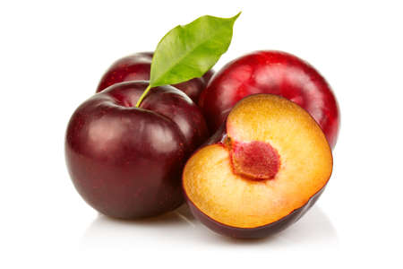 purple leaf plum: Ripe plums fruit with slices isolated on white background